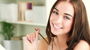 stock-footage-close-up-portrait-of-attractive-young-student-smiling